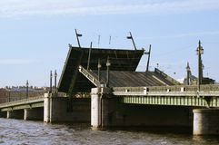 Drawbridge. Raising the Schmidt's Bridge over Neva river in Saint Petersburg, Russia stock photos