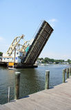 Drawbridge. Boat crossing under  opened drawbridge Stock Photos