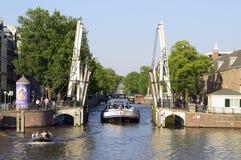Amsterdam,Drawbridge,bridge,channel,holland. Amsterdam. drawbridge in opening phase by passage boat. holland and amsterdam typicality Royalty Free Stock Image