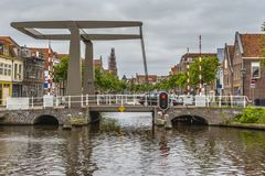 Drawbridge on one of the main channels of Alkmaar Netherlands Holland. Drawbridge and buildings of the city in one of the main channels of Alkmaar Netherlands royalty free stock photo