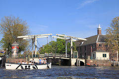 Drawbridge on a canal in Amsterdam Stock Images