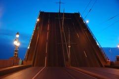 Drawbridge elevated. In evening St. Petersburg Stock Photo