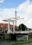 Drawbridge in Enkhuizen. A white painted drawbridge in Enkhuizen, a historical town along the IJsselmeer in the Netherlands Royalty Free Stock Image