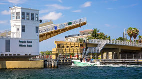 Drawbridge Opens to Let Boats Pass on Intracoastal Waterway in P. Ompano Beach, Florida Royalty Free Stock Image
