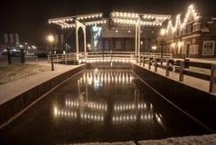 Drawbridge reflecting in water at winter night Royalty Free Stock Image