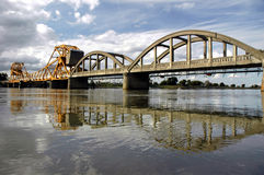 Drawbridge Reflection. Over Sacramento River Under Springtime Clouds,  California Royalty Free Stock Image