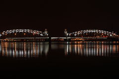 Drawbridge in St. Petersburg, illuminated by lights and reflected in the river Neva.  Stock Images