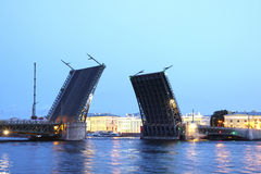 Drawbridge in St. Petersburg at white night in the light of lant Stock Photo