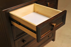Drawer closeup. Empty drawer closeup of wooden cabinet Stock Image