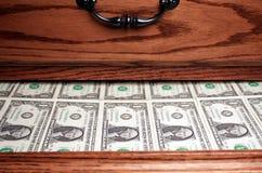 Drawer full of Money. Dresser drawer full of stacks of one dollar bills Royalty Free Stock Image
