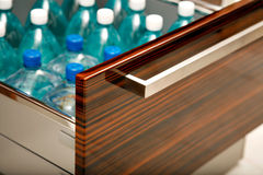 Kitchen drawer for water bottles Stock Photos