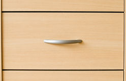 Drawers. A drawer from wood with metal handles Stock Photography