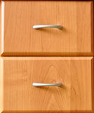 Drawers of the cabinet. Brown wooden cabinet with two similar drawers Stock Photo