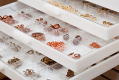 Drawers of jewelery findings stock photos