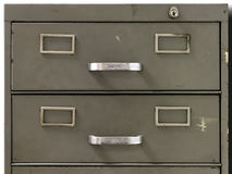 Drawers of an old metal filing cabinet. Front view of the drawers of metal filing cabinet of an old office royalty free stock photo