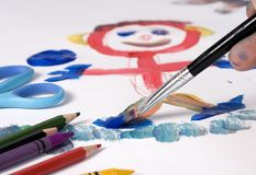 Drawing 1. Painting the family portrait with a paint brush royalty free stock photo
