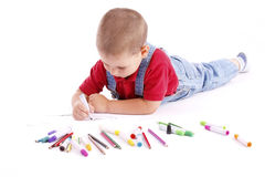 Drawing. Adorable little boy drawing whit colored pencil Royalty Free Stock Photo