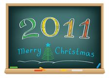 Drawing 2011 by a chalk. Drawing christmas year by a chalk on the classroom blackboard Royalty Free Stock Image