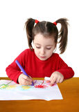 Drawing 3. Preschool girl drawing flowers Royalty Free Stock Image