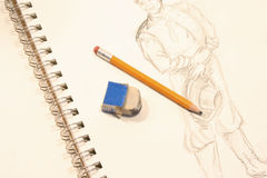 Drawing. Paper book with a theater character draw and a pencil and eraser Royalty Free Stock Photography