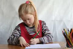 Drawing. A little girl drawing Royalty Free Stock Photography