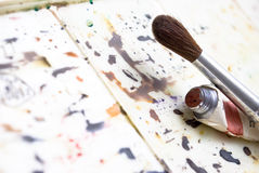 Drawing. Colour palette, brush and tube Royalty Free Stock Photography