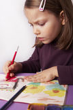Drawing. Young girl drawing a picture stock images