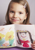 Drawing. Young girl presenting a drawing stock illustration