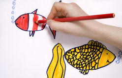 Drawing. Child`s hand scetch picture. Gold fish Stock Image