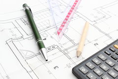 Drawing accesories and calculator on housing plan Stock Image