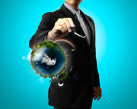 Drawing air and earth. Business man drawing air and earth royalty free stock images