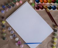Drawing album with color paints on the table stock photo