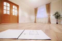 Drawing of apartment on floor in simple room Royalty Free Stock Photo