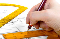 Drawing architect blueprints plan Royalty Free Stock Photos