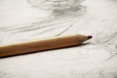 Drawing of artist by pencil on paper royalty free stock photo