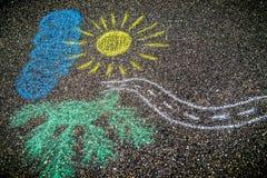 Drawing on asphalt. A chalk drawing of a landscape on asphalt Stock Photography