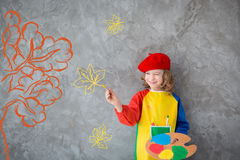 Drawing autumn theme. Imagination and freedom concept royalty free stock photography