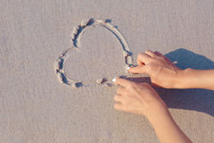 Drawing on beach sand heart symbol Royalty Free Stock Image