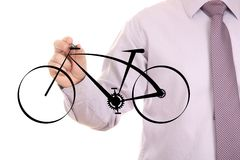 Drawing a bike. Businessman drawing  modern black bike Stock Photos