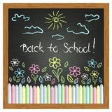 Drawing on the blackboard and colored chalks Royalty Free Stock Photo