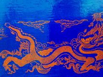 Golden dragon on a blue background. Drawing on a blue background similar to a dragon royalty free stock photos