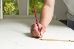 Drawing blueprint. Man drawing blueprint with pencil Royalty Free Stock Images
