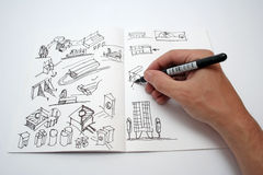 Drawing book. Shot of a person drawing in small book with pen and ink Royalty Free Stock Image