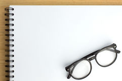 Drawing book. Glasses on drawing book on white background royalty free stock photo