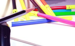 Drawing book with pencil, eraser, color sketch pens and sharpener. Educational concept background photo stock photos
