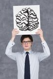 Drawing brain. Businessman holding poster with drawing brain Royalty Free Stock Image