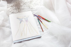 Drawing of bridal gowns in a designer shop Stock Photos