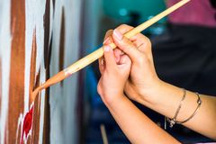 Drawing brush on the wall Royalty Free Stock Photo