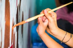 Drawing brush on the wall Stock Image