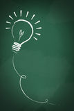 Drawing of a bulb idea on green board Royalty Free Stock Images